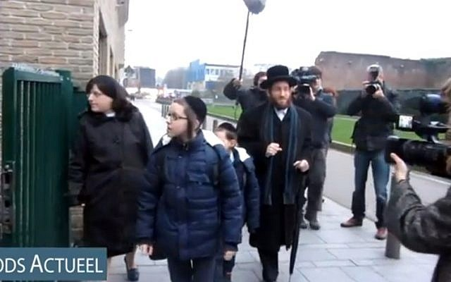 Rabbi Moshe Aryeh Friedman and his family arrive at the Yesode Hatora School in Antwerp, Belgium. (YouTube screenshot/File)