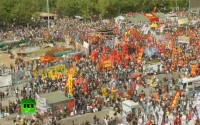 Protesters mass near Istanbul's Taksim Square on Sunday (image capture from Russia Today live feed)