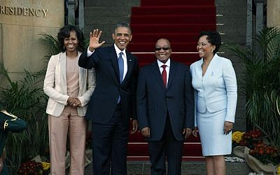 US President Barack Obama flanked by First Lady Michelle Obama, left, waves with South African President Jacob Zuma, second right, and his wife Tobeka Madiba Zuma, right, on the steps of Union Building in Pretoria, South Africa, Saturday June 29, 2013. (AP Photo/Jerome Delay)