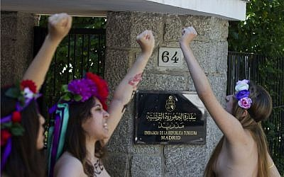 Activists of FEMEN shout for the release of fellow activists, who are imprisoned in Tunisia during a protest outside the Tunisian embassy in Madrid, Spain Wednesday June 12, 2013. (photo credit: AP/Paul White)