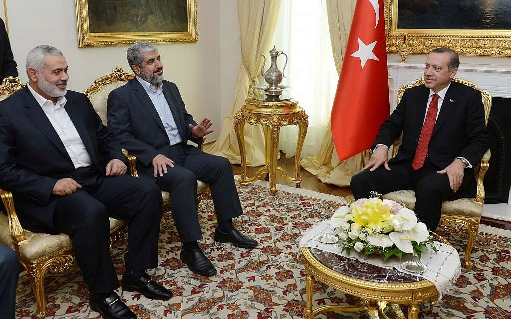 Turkish Prime Minister Recep Tayyip Erdogan, right, seen during a meeting with Khaled Mashaal, the Hamas chief in exile, center, and Gaza's prime minister Ismail Haniyeh in Ankara, Turkey, Tuesday, June 18, 2013. (AP/Yasin Bulbul, Prime Minister's Press Office)