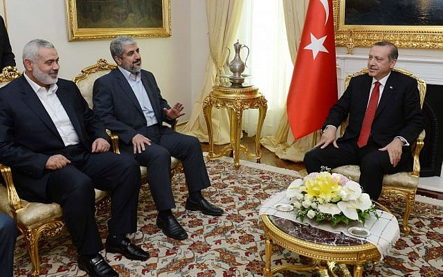 Turkish Prime Minister Recep Tayyip Erdogan, right, seen during a meeting with Khaled Mashaal, Hamas' then chief in exile, center, and Gaza-based leader Ismail Haniyeh in Ankara, Turkey, on June 18, 2013. (AP/Yasin Bulbul, Prime Minister's Press Office)
