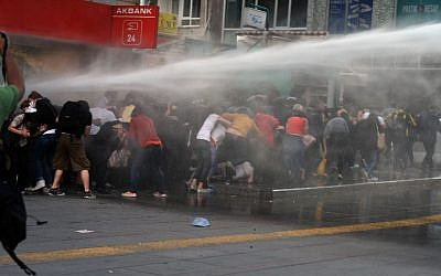 Riot police use water cannon to disperse protesters in the Turkish capital, Ankara, late Wednesday, June 5, 2013 (photo credit: AP)