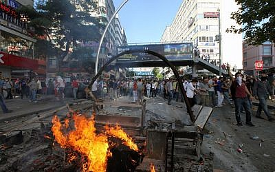 """Turkish youths shout slogan """" Tayyip, resign! """" as they clash with security forces in Ankara, Turkey, Saturday, June 1, 2013.  (Photo credit: AP/Burhan Ozbilici)"""