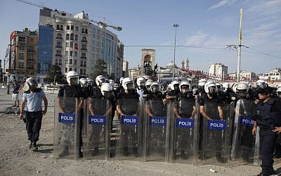 Turkish riot policemen take their position during clashes in Taksim Square in Istanbul on Tuesday, June 11, 2013. (photo credit/Kostas Tsironis/AP)
