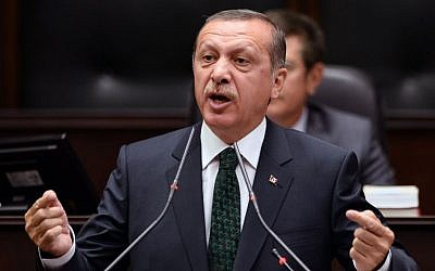 Turkish Prime Minister Recep Tayyip Erdogan addresses his supporters and lawmakers at the parliament in Ankara, Turkey, Tuesday, June 25, 2013 (photo credit: AP)