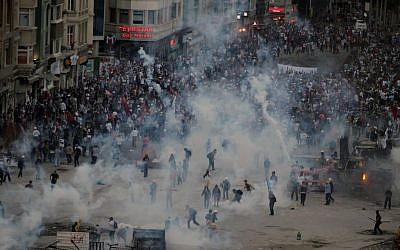 Police shoot tear gas ot protesters in Taksim Square Tuesday. (photo credit: AP/Thanassis Stavrakis)