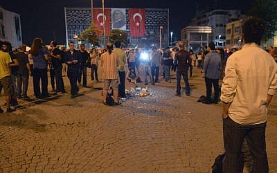 Erdem Gunduz, right, stands silently on Taksim Square in Istanbul, Turkey, early Tuesday, June 18, 2013. (Photo credit: AP)