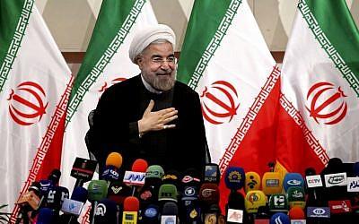 Hasan Rowhani speaking to the press Monday. (photo credit: AP/Ebrahim Noroozi)