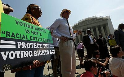 Supporters of the Voting Rights Act waiting outside the US Supreme Court building in Washington after the court struck down a section aimed at protecting minority voters, June 25, 2013. (photo credit: Win McNamee/Getty via JTA)