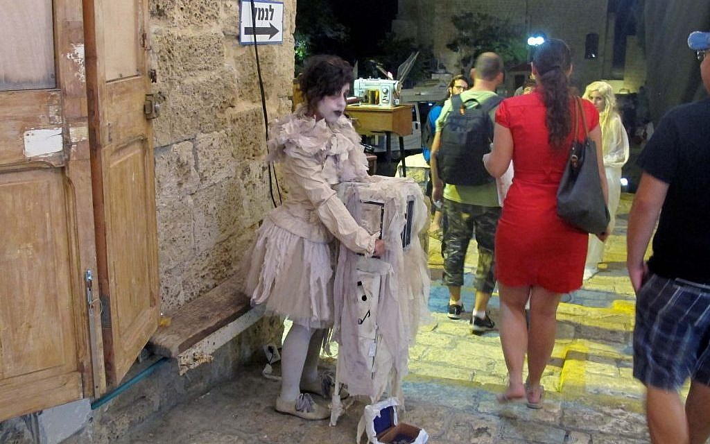 Local street performers flocked the alleyways of Jaffa for White Night (photo credit: Leeor Bronis/Times of Israel)