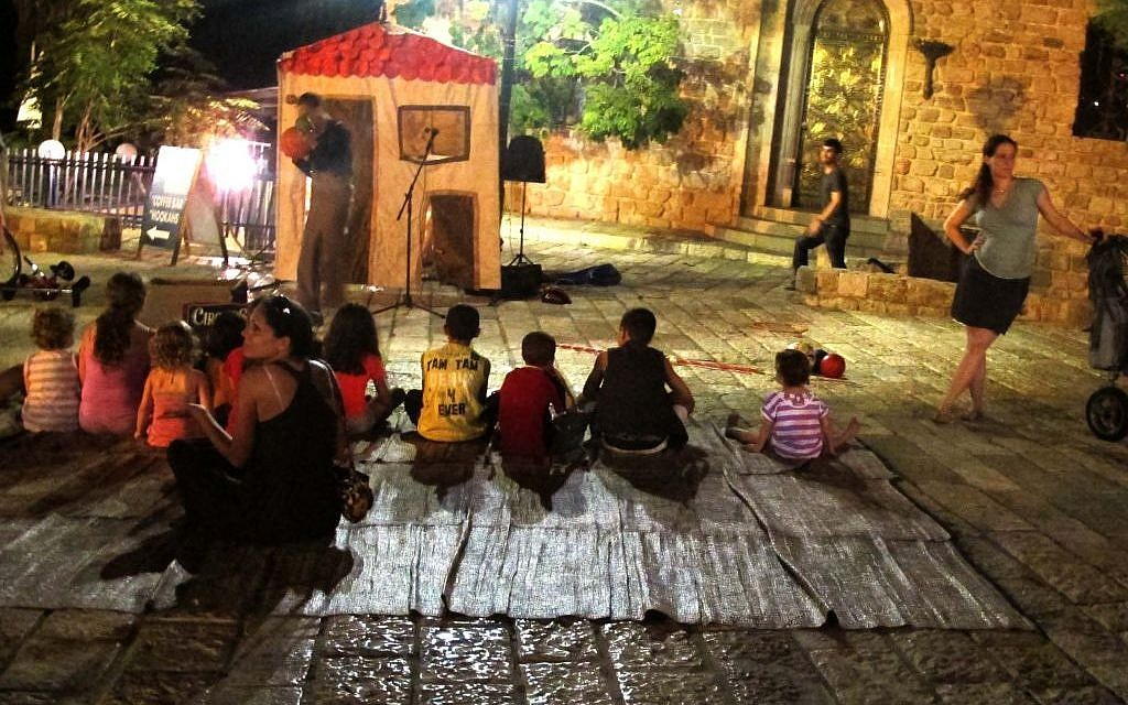 Children got in on the fun of White Night as well, catching some skits and comedy routines on the streets of Jaffa (photo credit: Leeor Bronis/Times of Israel)