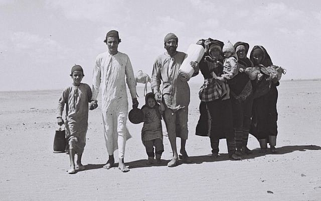A Yemenite family walking through the desert on its way to a transit camp set up by the JDC, in 1949. (photo credit: CC BY-SA, Kluger Zoltan, Wikipedia)