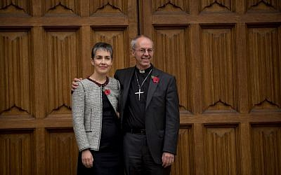 Justin Welby, right, poses for photographers with his wife Caroline following the announcement he will become the next archbishop of Canterbury, Nov. 9, 2012. (photo credit: AP Photo/Matt Dunham)