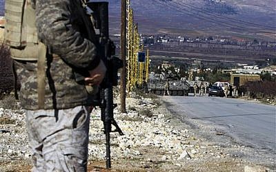 Illustrative photo of Lebanese army soldiers at a checkpoint at the entrance of Arsal, a Sunni Muslim town in eastern Lebanon near the Syrian border, Feb. 2, 2013 (AP Photo/Bilal Hussein)