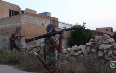 Members of the Grandson of the Prophet rebel brigade operating near Hama. (photo credit: image capture from NYTimes video)