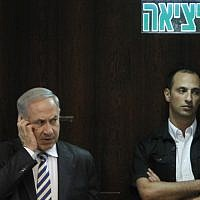 Prime Minister Benjamin Netanyahu speaking on a cellphone during a Knesset session on June 5, 2013 (Miriam Alster/Flash90)
