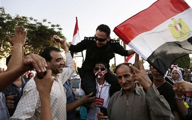 A protest against the Muslim Brotherhood and Egyptian President Mohammed Morsi in front of the Ministry of Defense, in Cairo, Egypt, Wednesday, June 26, 2013 (AP/Hassan Ammar)