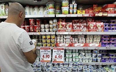Illustrative: A man shops at a Rami Levy supermarket. (Nati Shohat/Flash90)