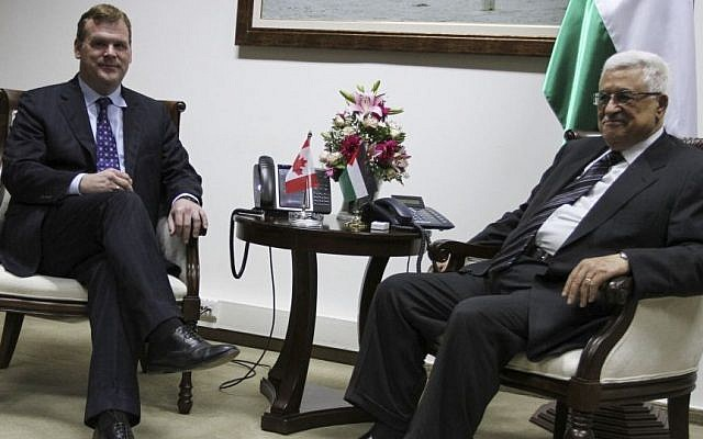 Palestinian Authority President Mahmoud Abbas, right, speaks with Canada's Foreign Minister John Baird during their meeting in the West Bank city of Ramallah, Monday, June 17, 2013. (Photo by Issam Rimawi/FLASH90)