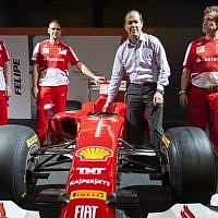 Jerusalem Mayor Nir Barkat with Ferrari technical crew members next to a Ferrari Formula 1 racing car, on display at the Old Jerusalem Train Station, June 9, 2013. (photo credit: Flash 90)