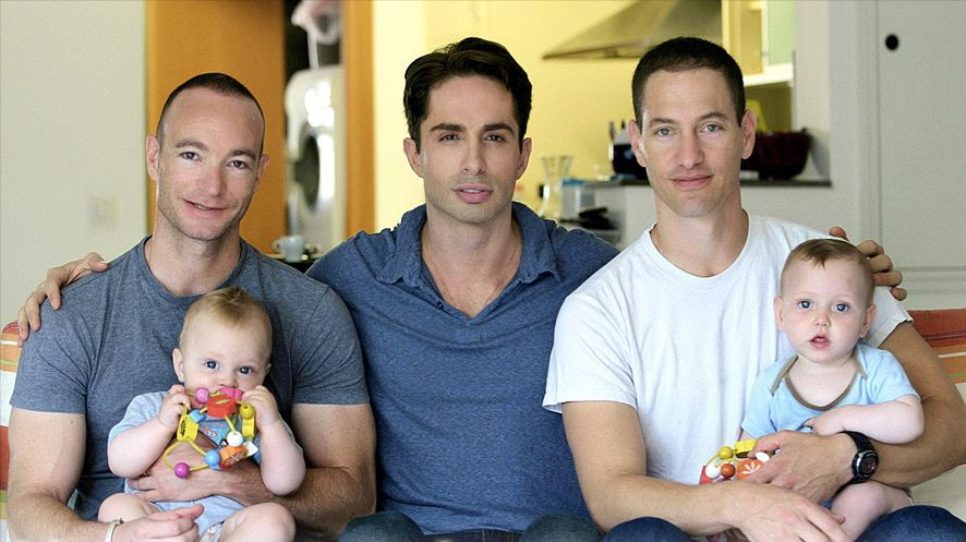Michael Lucas, center, with a pair of gay fathers featured in his documentary.