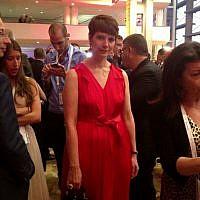 Hila Rahav, wife of PR guru Rani Rahav, in red (photo credit: Sarah Tuttle-Singer/Times of Israel)