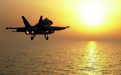 Illustrative photo of a US F/A-18 Hornet over the Persian Gulf in 2001, as part of the force supporting a no fly zone over southern Iraq. (photo credit: Department of Defense/George Branham, US Navy)