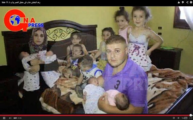 The Al Batash family and their 11 children (image capture YouTube)