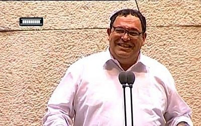 Education Minister Shai Piron laughs during a Knesset debate on June 3, 2013. (screen capture: Youtube/99knesset)