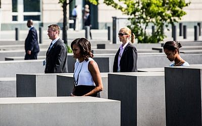 First lady Michelle Obama and daughter Malia visiting the the Holocaust memorial in Berlin, June 19, 2013. (Photo credit: Marco Priske / Stiftung Denkmal/JTA)