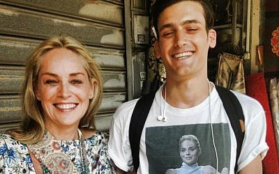 Sharon Stone with a fan in Tel Aviv wearing a T-shirt with a picture from one of her most famous movie scenes. (photo credit: r/pics/Imgur)