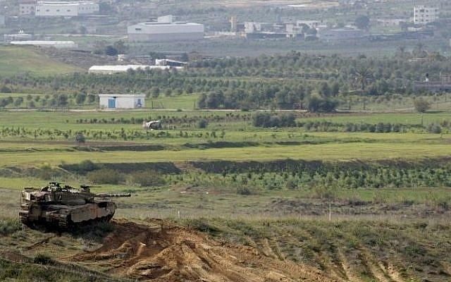 Illustrative. An Israeli tank overlooks the Gaza Strip. (Courtesy: Yad L'shiryon)