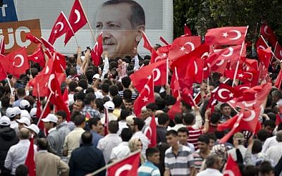 Supporters of Turkish Prime Minister Recep Tayyip Erdogan wait for his arrival in Ankara, Turkey, on Sunday, June 9, 2013. (AP/Vadim Ghirda)