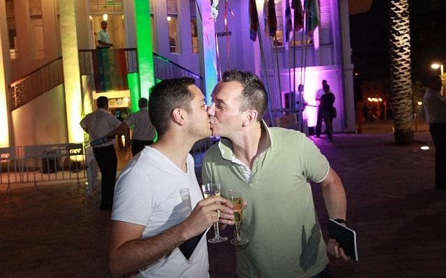 Vincent Autin and Bruno Boileau, France's first gay newlyweds, kiss in Tel Aviv on their honeymoon, June 2013. (photo credit: Courtesy Municipality of Tel Aviv)