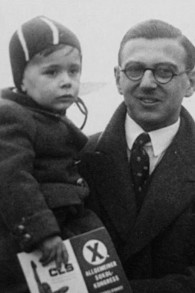 A young Nicholas Winton with a rescued child. (hoto credit: Courtesy of Menemsha Films)