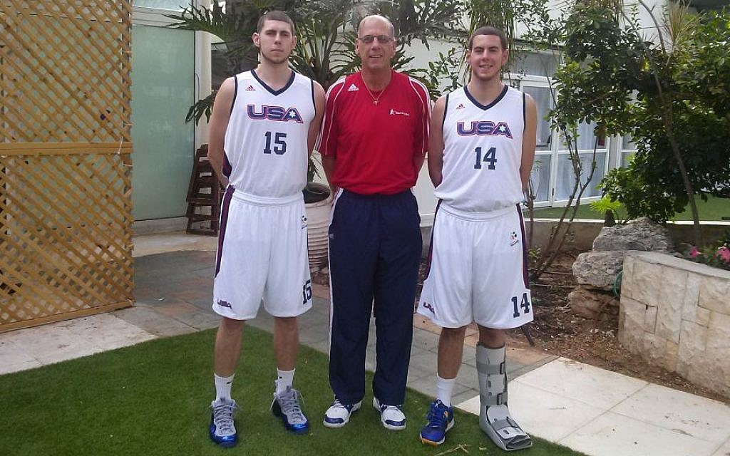 Mike Carter (center) with his boys, Ben and Timothy, before the 19th Maccabiah (photo credit: Courtesy)