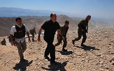 Defense Minister Moshe Yaalon, center, touring the border with Egypt Tuesday. (photo credit: Ariel Hermoni/ Defense Ministry)