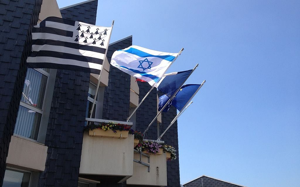 Atop the Douarnenez city hall, the Israeli flag features in between the French and Breton flags (photo credit: Elhanan Miller/Times of Israel)