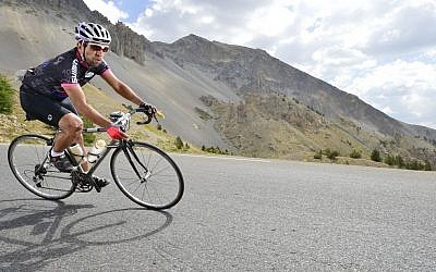 Guy Elyahou rides his bike (photo credit: courtesy)