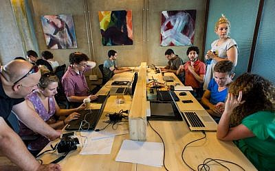 Web and tech pros work at the Do It Good Hackathon (Photo credit: Courtesy)