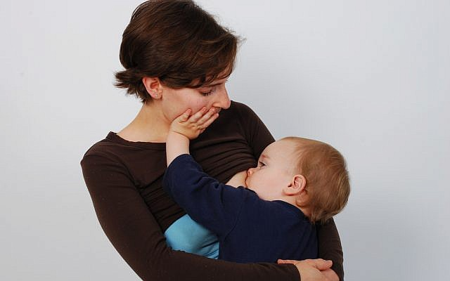 Illustrative photo of a mother breast-feeding her baby. (photo credit: CC BY-A Mothering Touch/Flickr)