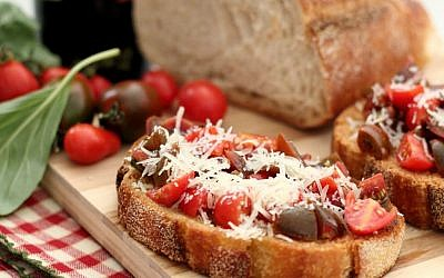 Bruschetta with cherry and grape tomatoes, and sliced basil (photo credit: Andrea Brownstein/Photoli Photography)