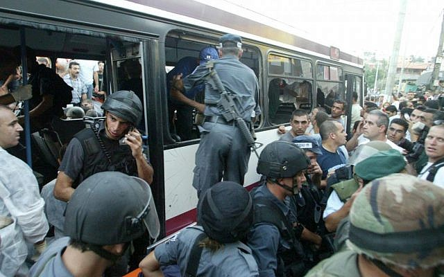 Security forces inspect the bus in which Eden Natan Zada opened fire in 2005, killing four. (photo credit: AP/Alex Roskovsky)