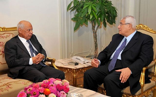 Interim President Adly Mansour, right, meets with Hazem el-Beblawi, left, in Cairo, Egypt, Tuesday, July 9 (photo credit: AP/Egyptian Presidency)