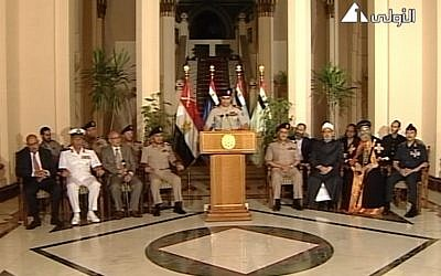 Lt. Gen. Abdel-Fattah al-Sisi, center, flanked by military and civilian leaders, July 3, 2013 (photo credit: AP/Egyptian State Television)