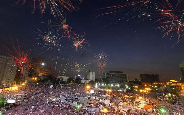 Fireworks burst over opponents of Egypt's Islamist President Mohammed Morsi in Tahrir Square in Cairo, Egypt, Tuesday, July 2 (photo credit: AP/Amr Nabil)