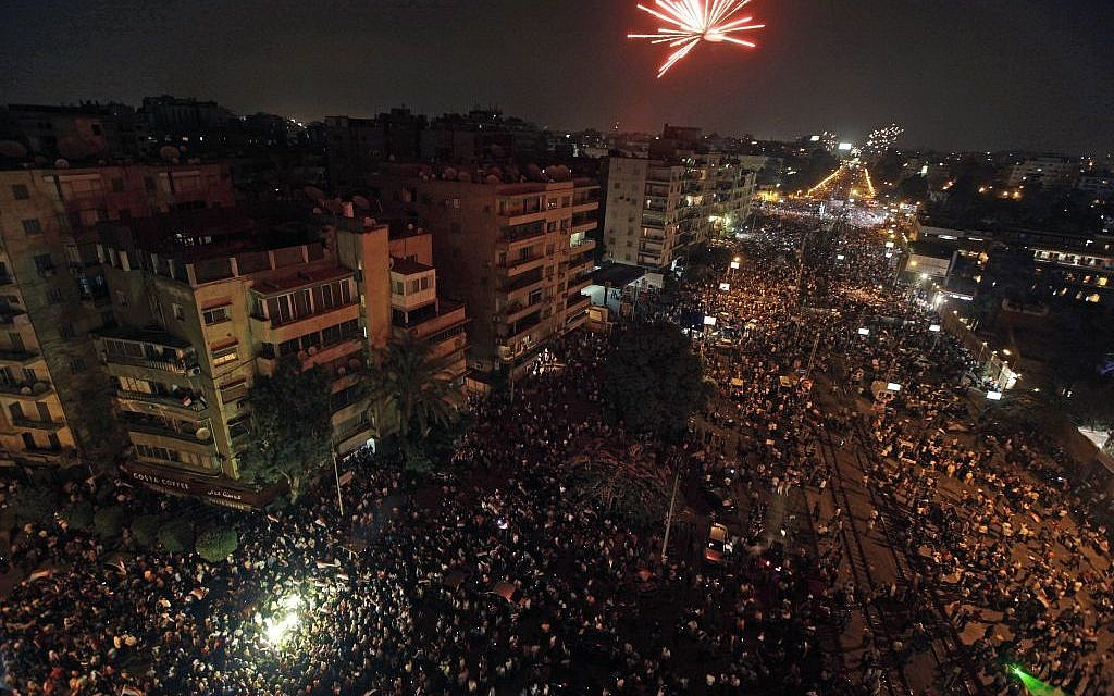 Fireworks light the sky moments after Egypt's military chief says the president is replaced by chief justice of constitutional court outside the presidential palace in Cairo, Egypt on Wednesday. (photo credit: AP/Nariman El-Mofty)