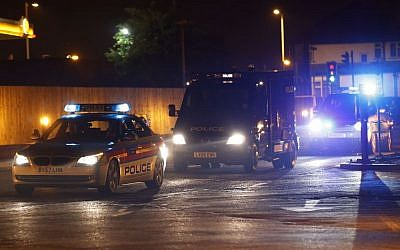 A police van carrying radical cleric Abu Qatada arrives, under escort, at RAF Northolt in London for his deportation to Jordan, where he faces a retrial for his alleged involvement in terrorist plots, on Sunday, July 7, 2013. (photo credit: AP Photo/Sang Tan)
