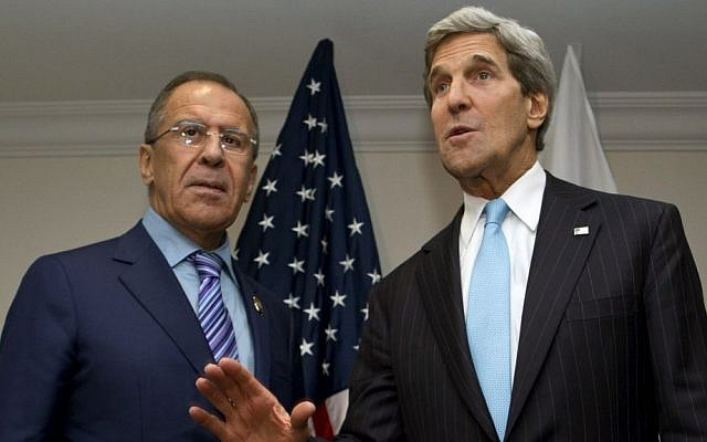 US Secretary of State John Kerry, right, takes questions from reporters with Russian Foreign Minister Sergey Lavrov in July 2013 (photo credit: AP/Jacquelyn Martin/File)